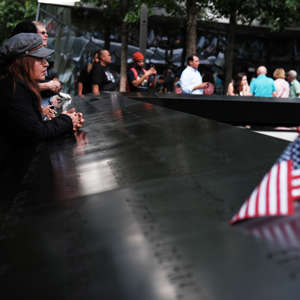 a group of people on a rainy day: Lower Manhattan Prepares To Mark 18th Anniversary Of September 11th Attacks