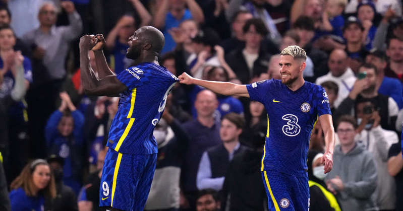 a man standing in front of a crowd: Romelu Lukaku celebrates goal for Chelsea in the Champions League