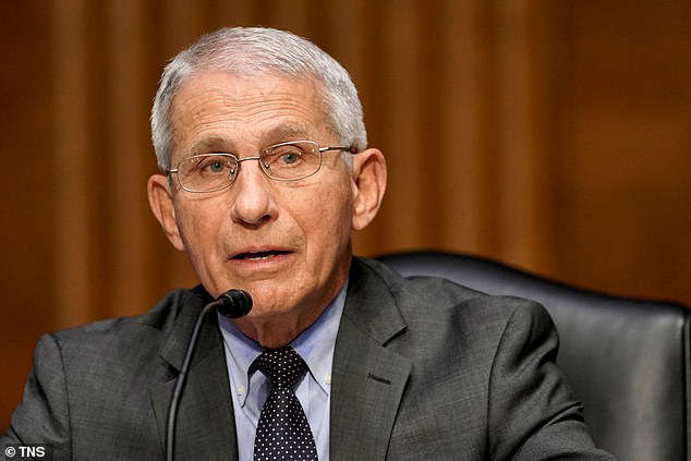 Anthony S. Fauci wearing a suit and tie: (