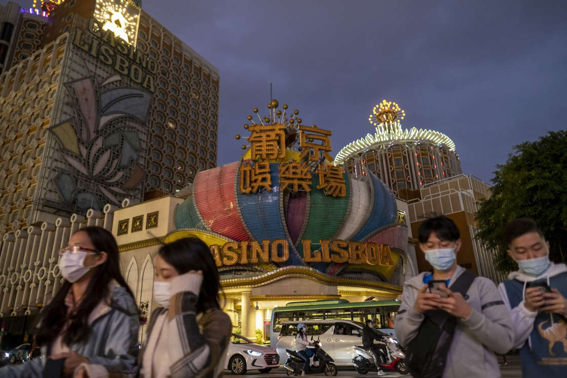 a group of people standing and talking on the phone: View of Macau As Casino Operators Shut Business For 15 Days