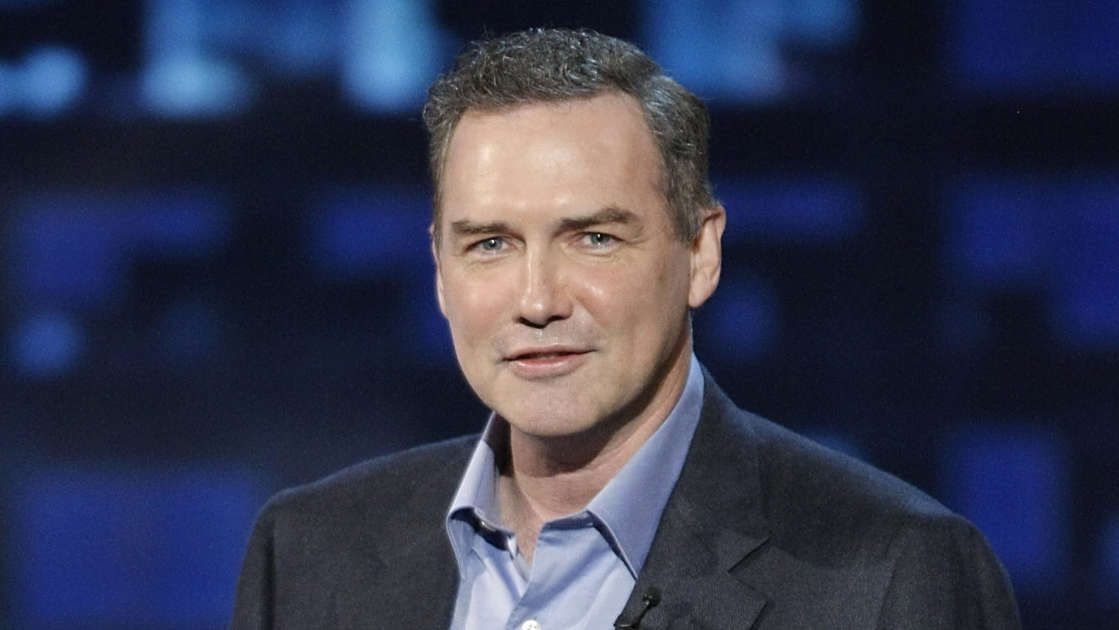 Norm MacDonald wearing a suit and tie
