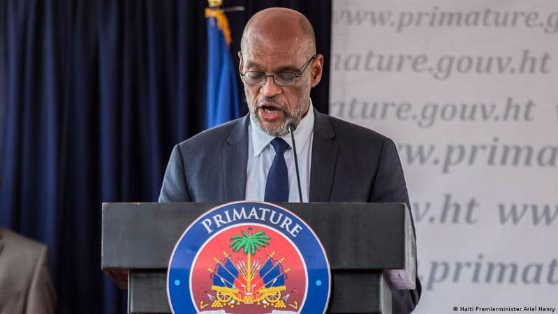 Earl Ofari Hutchinson wearing a suit and tie: Prime Minister is accused of having contacted a suspect the night of the murder