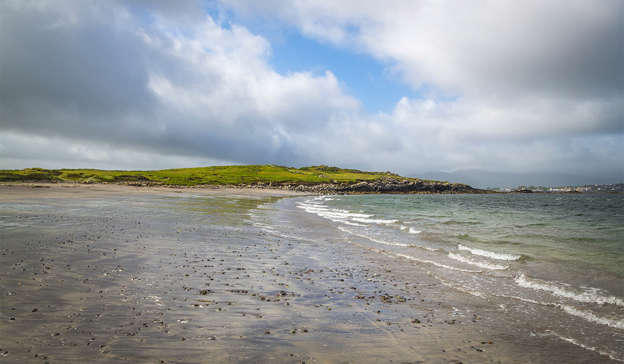 a sandy beach next to a body of water: The child, later dubbed 'Baby John', was discovered with 28 stab wounds on White Strand Beach in Caherciveen in 1984, leading to a Garda investigation, a tribunal and a massive political debate. Pic: Shutterstock