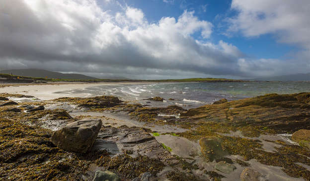 a group of clouds on a rocky beach: Pic: Shutterstock