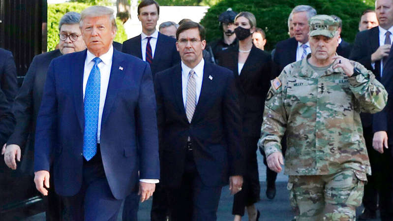 Stephen Joel Trachtenberg, Donald Trump posing for the camera: Donald Trump outside the White House in June 2020 with officials including Gen Mark Milley (R)