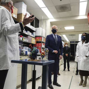 a group of people standing in a room: President Biden Visits The National Institutes Of Health