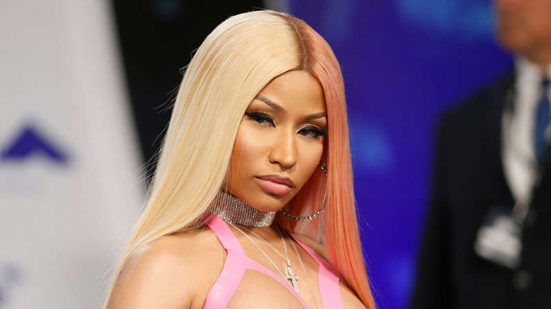 Nicki Minaj with pink hair looking at the camera: Nicki Minaj made claims about the COVID-19 vaccine that were debunked by scientists