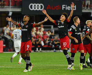 a group of people playing football on a field: D.C. United's Ola Kamara, left, and Kevin Paredes celebrate after Kamara scored Wednesday night at Audi Field. (Ricky Carioti/The Washington Post)