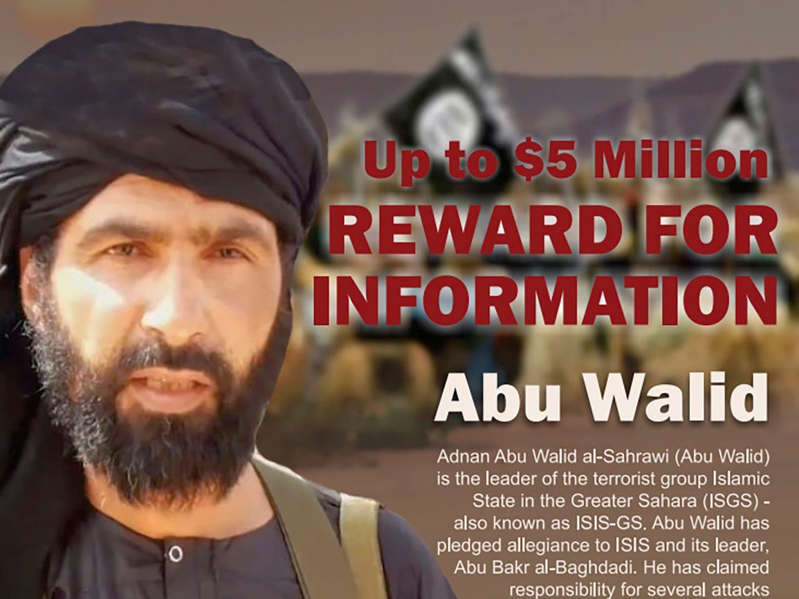 a man wearing a hat: Adnan Abu Walid al-Sahrawi in an undated Rewards For Justice wanted poster Associated Press