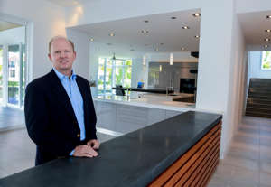 Roger Pettingell in a suit and tie: Real estate agent Roger Pettingell at a home for sale on Harbor Gate Way on Longboat Key on May 13, 2015.