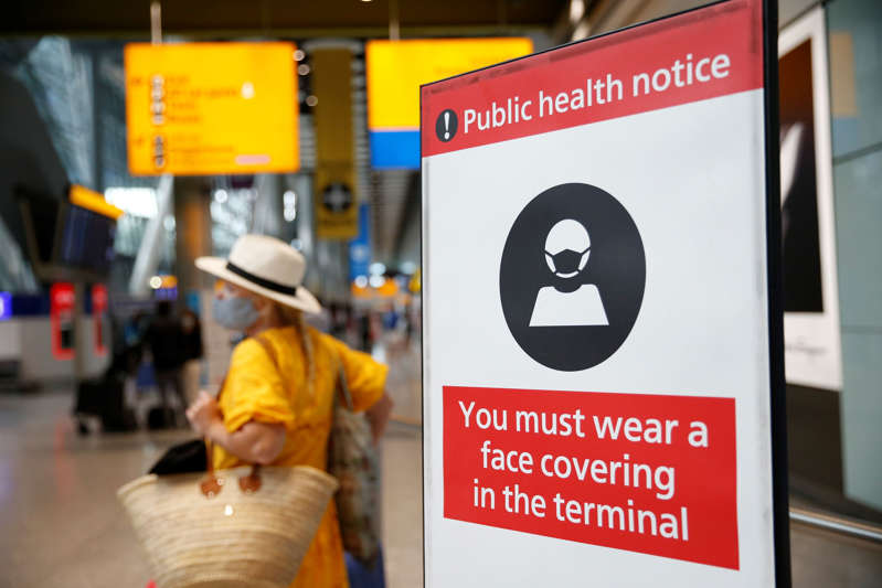 File: A public health notice displayed at the International Arrivals gate at Heathrow Airport on August 7, 2021 in London, England.  (Photo by Hollie Adams/Getty Images)