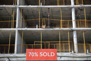 a building with a metal fence: Passive real estate investment offers returns from rent and rising prices. (Getty Images)