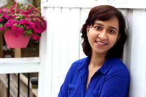 a woman in a blue shirt and smiling at the camera: Khushboo Jha, Founder and CEO of BuyProperly wanted to make real estate investment easier