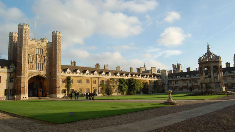a clock tower in front of a building: Cambridge University dropped from first to third in the latest rankings. File pic
