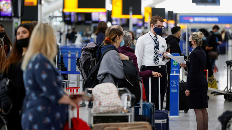 a person standing in front of a crowd of people: Some airlines say the changes do not go far enough