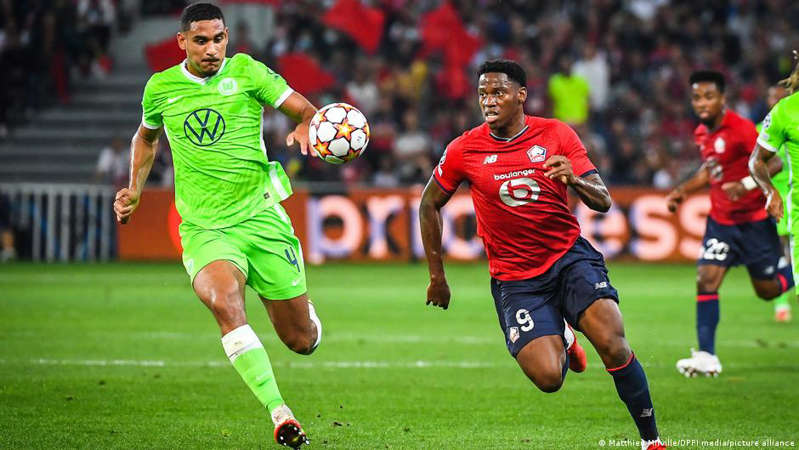 a group of men playing a game of football: Maxence Lacroix showed his worth on his return to France against Lille