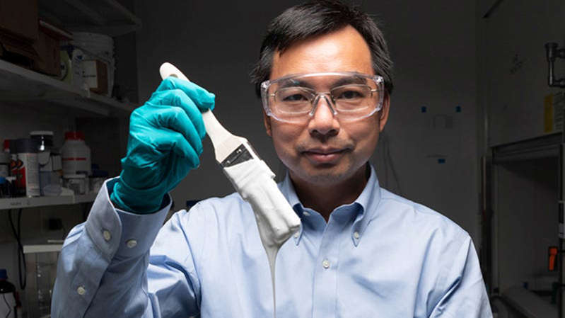 a man wearing glasses: Xiulin Ruan, a Purdue University professor of mechanical engineering, and his students have created the whitest paint on record.