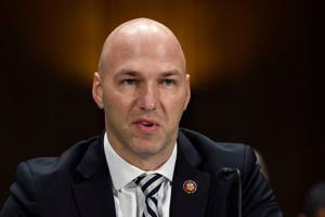 Anthony Gonzalez wearing a suit and tie: Rep. Anthony Gonzalez speaks during a Senate Commerce subcommittee hearing.