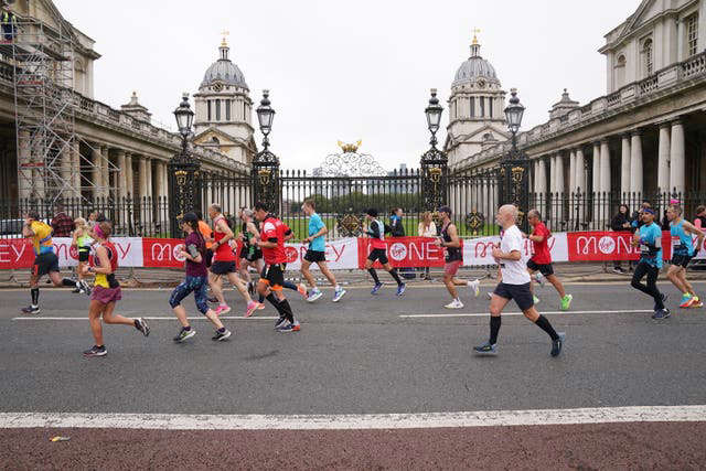 Runners pass the Old Naval College, Greenwich (Jonathan Brady/PA)
