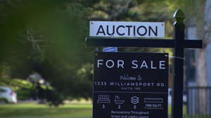 A for sale sign put up by On The Block Auctions, a real estate company that offers a transparent bidding process through online auctions.