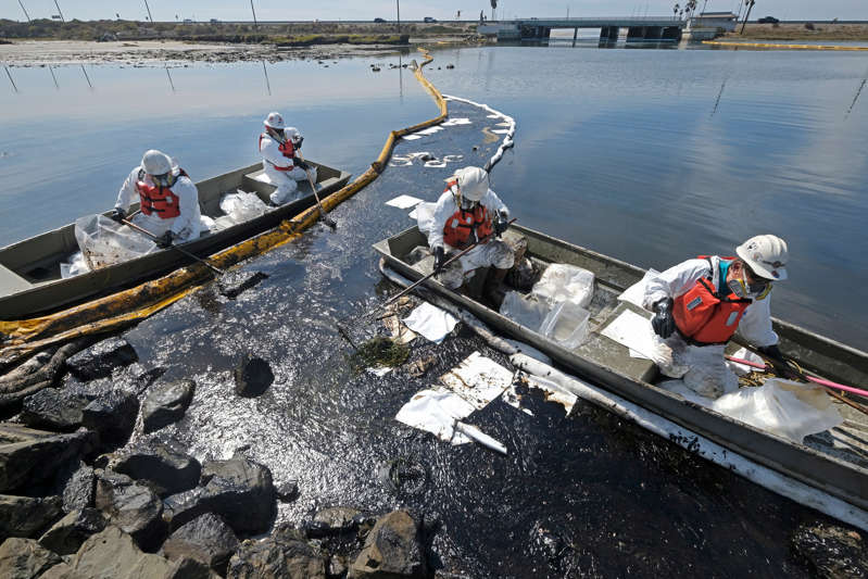 Cleanup contractors deploy skimmers and floating barriers known as booms to try to stop further oil crude incursion (AP)