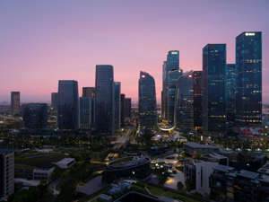 Buildings stand at the Qianhai business district at sunset on May 29, 2021 in Shenzhen, the city where Fantasia is based. He Shaoping/VCG via Getty Images)