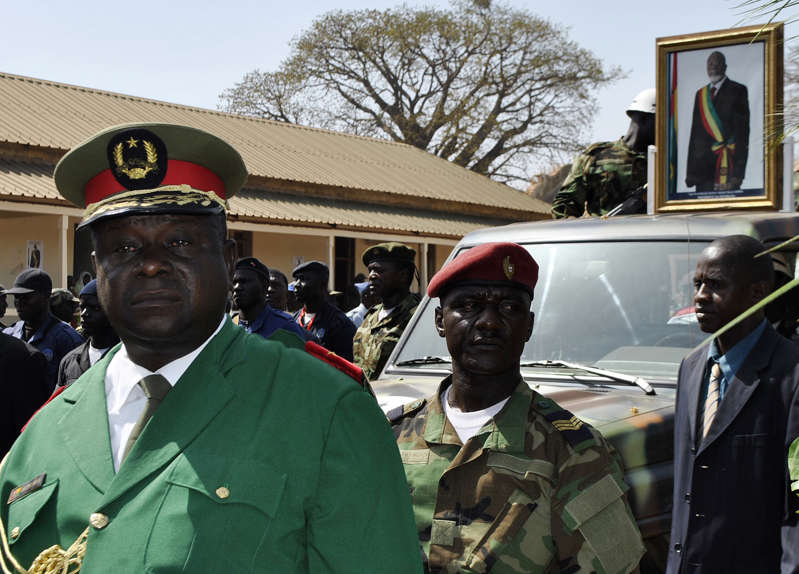 Gen. Antonio Indjai mourns as he walks in front of a vehicle adorned by a photo of Guinea-Bissau's late president Malam Bacai Sanha during a state funeral in Bissau in 2012.