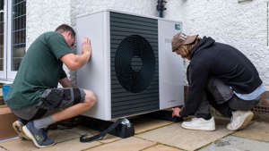 Workers from Solaris Energy installing an air source heat pump into a house in Folkestone, United Kingdom.
