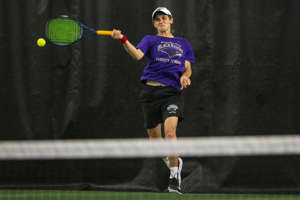 Bloomfield Hills' Noah Roslin returns a volley to Grand Rapids Catholic Central's Ned Curley during the MHSAA Division 1 state tennis finals at the Markin Tennis Center on the campus of Kalamazoo College at Kalamazoo, Michigan on Thursday, Oct. 14, 2021. Friday matches were moved inside due to rain.