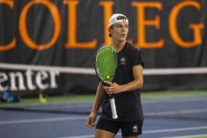 Brother Rice's Dimitri Moriarty looks toward the seating area between sets during the MHSAA Division 1 state tennis finals at the Markin Tennis Center on the campus of Kalamazoo College at Kalamazoo, Michigan on Thursday, Oct. 14, 2021. Friday matches were moved inside due to rain.