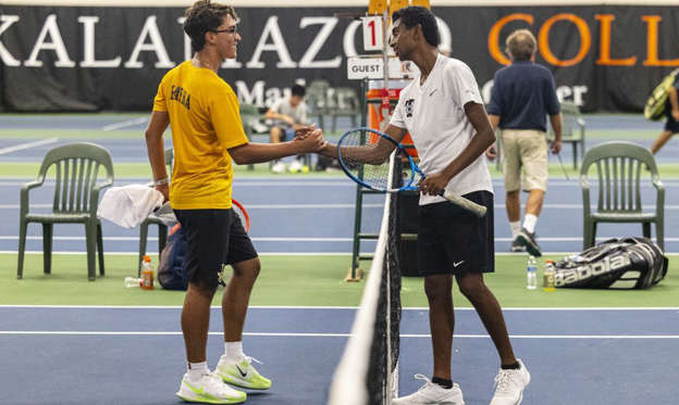 Troy's Rishi Shetty shakes hands with Rochester Adams' Patrick Barna after their match in the MHSAA Division 1 state tennis finals at the Markin Tennis Center on the campus of Kalamazoo College at Kalamazoo, Michigan on Thursday, Oct. 14, 2021. Shetty defeated Barna to move to the next round. Friday matches were moved inside due to rain.