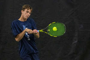 Ann Arbor Skyline's Anthony Van Oyen returns a serve during the MHSAA Division 1 state tennis finals at the Markin Tennis Center on the campus of Kalamazoo College at Kalamazoo, Michigan on Thursday, Oct. 14, 2021. Friday matches were moved inside due to rain.