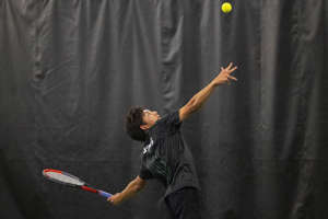 Novi's Takuya King serves the ball to Rockford's Luke Johnson during the MHSAA Division 1 state tennis finals at the Markin Tennis Center on the campus of Kalamazoo College at Kalamazoo, Michigan on Thursday, Oct. 14, 2021. Friday matches were moved inside due to rain.