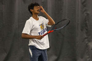 Saline's Amod Talekar returns a volley reacts after missing a shot during the MHSAA Division 1 state tennis finals at the Markin Tennis Center on the campus of Kalamazoo College at Kalamazoo, Michigan on Thursday, Oct. 14, 2021. Friday matches were moved inside due to rain.