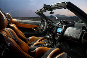 Remove the carbon-fiber top and headroom goes to infinity. Every bit of the fantastic interior is unique to the Huayra. The wooden shift knob is a tribute to the Porsche 917.