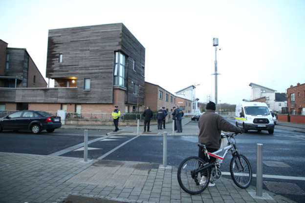 Gardaai at the scene at Barnwell Drive Ballymun Dublin 11 on the morning after the shooting.