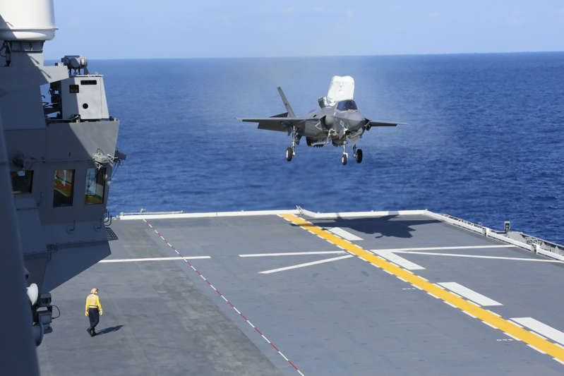 A U.S. Marine Corps F-35B Lightning II aircraft with Marine Fighter Attack Squadron 242 operates aboard the Japan Maritime Self-Defense Force helicopter carrier JS Izumo in the western Pacific on October 3, 2021.