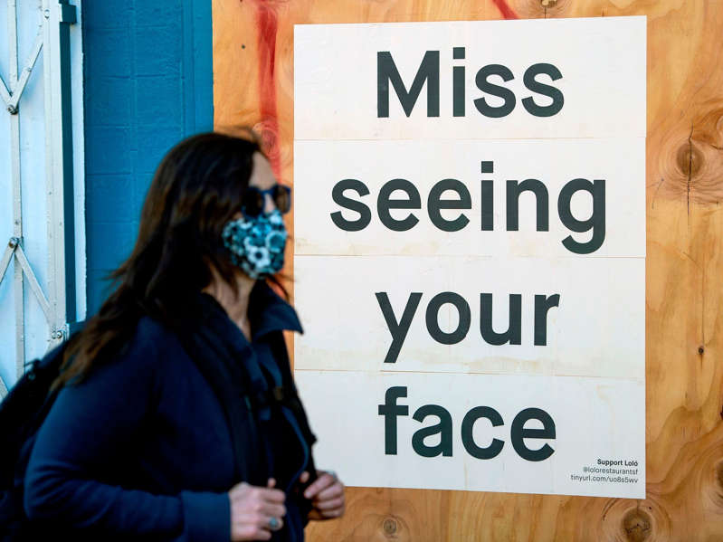 A woman in a face mask walks in San Francisco on April, 1, 2020. Josh Edelson/AFP/Getty Images