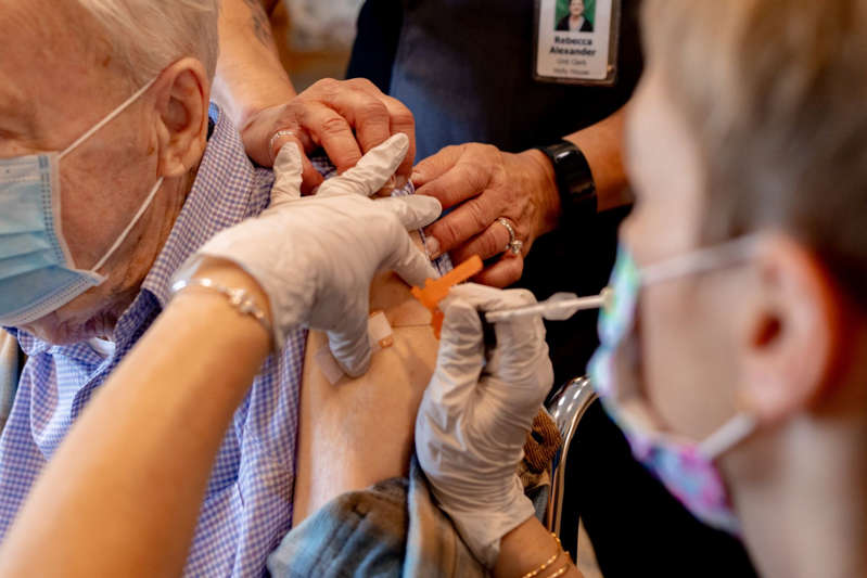 A Senior Living Facility Administers A Third Covid-19 Dose To Residents