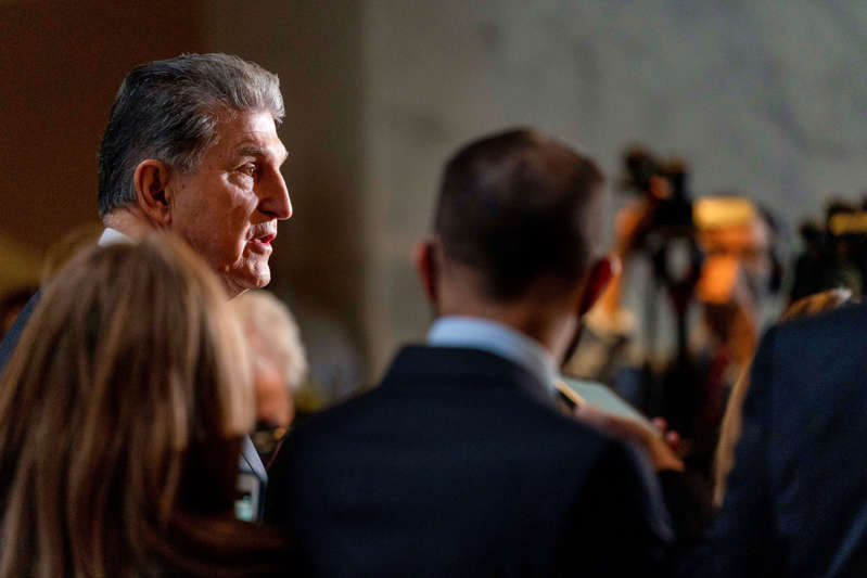 Sen. Joe Manchin, D-W.Va., speaks at a news conference outside of his office on Capitol Hill in Washington, Wednesday, Oct. 6, 2021. (AP Photo/Andrew Harnik)