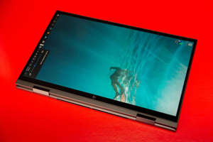 The big, widescreen display and 4-pound weight makes it an unruly handheld tablet. Sarah Tew/CNET