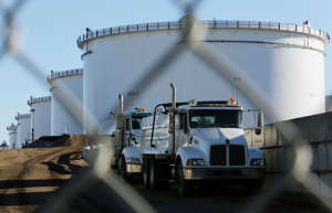 Crude oil tanks at Kinder Morgan's North 40 terminalin Sherwood Park, Alberta, Canada. Oil companies are seeking government support to build carbon capture facilities. Reuters