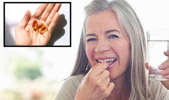 Woman consuming vitamin d
