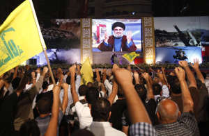 Hassan Nasrallah delivers a televised speech on fuel supplies from Iran. Reuters