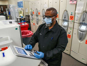 Brent Cox prepares blood samples for testing at CPA Labs, a subsidiary of Norton Healthcare.