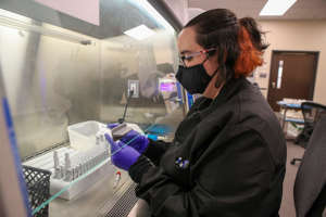 Elise Spaulding prepares COVID-19 samples for testing at CPA Labs, a subsidiary of Norton Healthcare.