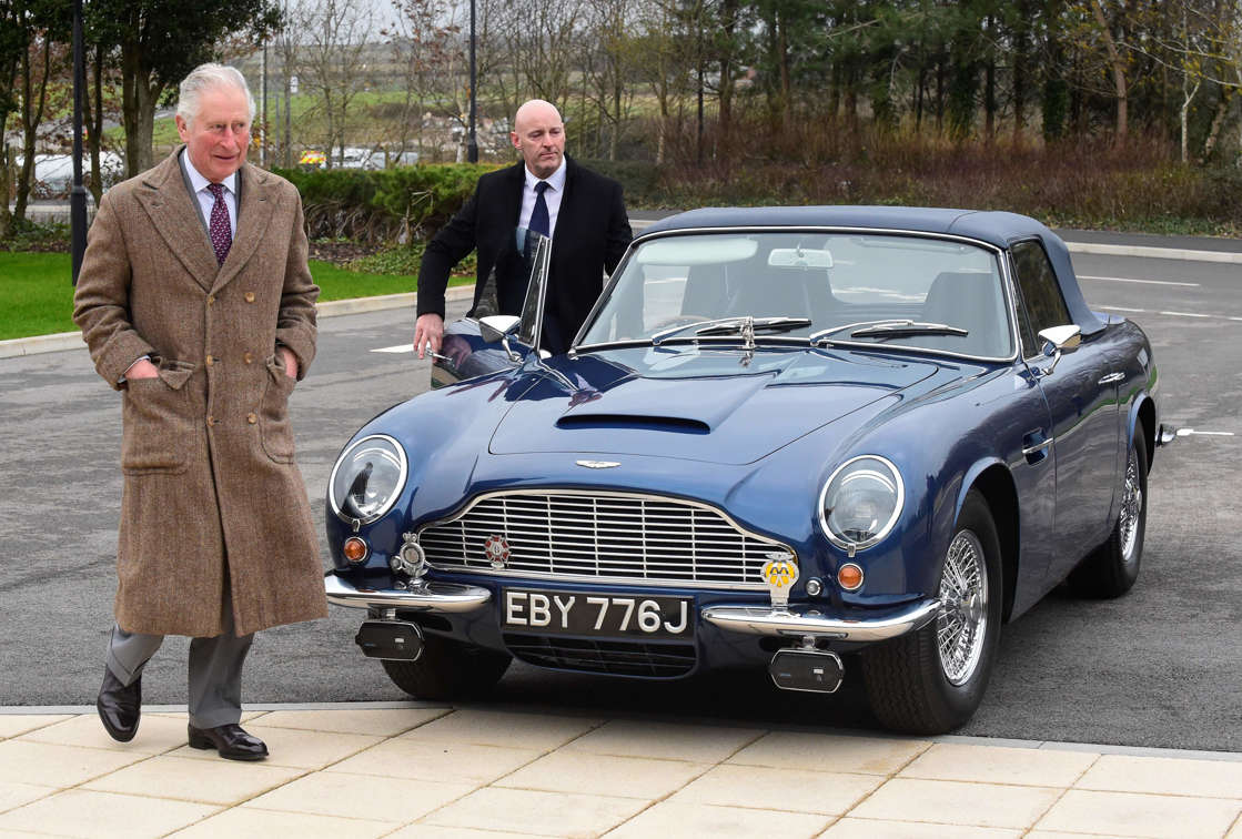 Britain's Prince Charles, Prince of Wales walks away from his Aston Martin DB6 during his visit to the new Aston Martin Lagonda factory in Barry, Wales on Feb. 21, 2020.