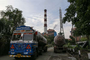 A Bharat Petroleum Ltd. tanker travels along a road near the Tata Power Co. Trombay Thermal Power Station in Mumbai, India, on Wednesday, Oct. 6, 2021. India is grappling with an escalating crisis as stockpiles of coal, the fuel used to generate about 70% of the nation's electricity, dwindle to the lowest in years just as power demand is set to surge. Photographer: Dhiraj Singh / Bloomberg