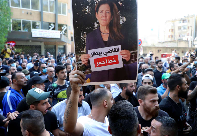 A supporter of the Lebanese Shiite group Hezbollah and its allies holds up a picture of U.S. Ambassador to Lebanon Dorothy Shea during a protest Judge Tarek Bitar in Beirut, Oct. 14, 2021.
