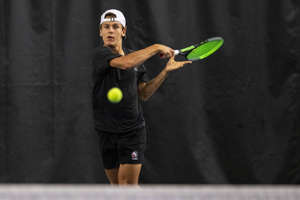 Brother Rice's Dimitri Moriarty returns a serve during the MHSAA Division 1 state tennis finals at the Markin Tennis Center on the campus of Kalamazoo College at Kalamazoo, Michigan on Thursday, Oct. 14, 2021. Friday matches were moved inside due to rain.